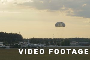 Paratrooper landing with parachute - slowmotion 60fps