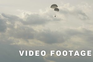 Paratrooper landing with two parachutes - slowmotion 60fps