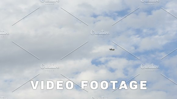 Small aiplane flies in the sky