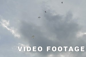 Parachutists fly in the sky