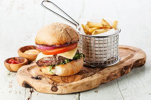 Burger with meat and French fries