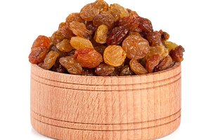 raisins in a wooden bowl isolated on white background