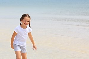 little girl have fun on the beach