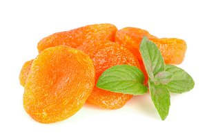 Dried apricots with mint leaves isolated on white background