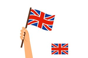 Hand holding flag of Britain