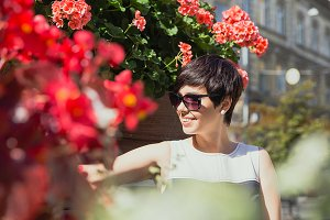 Smiling woman in sunglasses