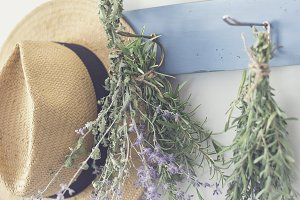 Hanging herbs next to hat