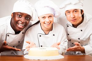 Team Of Confectioners With Gateau