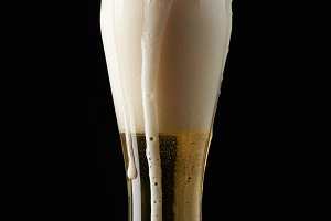 Beer foam coming from glass