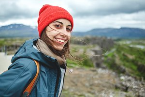 Cheerful woman posing on nature