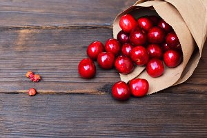 Red cherry in a paper bag