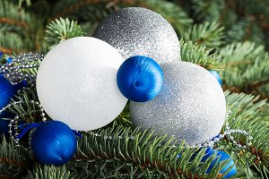 Three christmas balls on a tree.