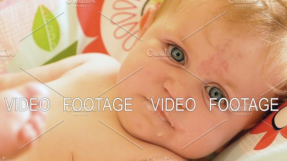Adorable Happy Baby Is Looking Into The Camera