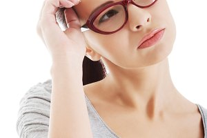 Portrait of thoughtful woman in eyeglasses.