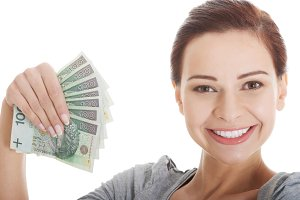 Young beautiful casual woman holding large sum of money.