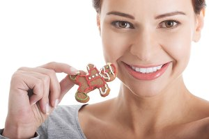 Beautiful casual woman with gingerbread christmas cookies.