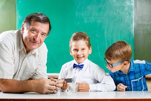 Two schoolboys and their teacher in class