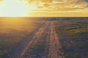 Road to sunset on the Baltic Sea in summer