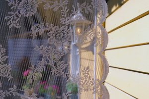 Tulle on the window of a summer house
