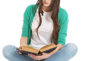 Young beautiful student sitting with book, reading, learning.