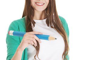 Beautiful young woman writing on copy space with pencil.