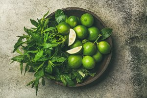 Flat lay of fresh limes and mint