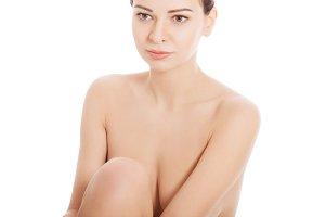 Naked beautiful woman. Torso, body part.