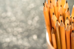the stack of pencils in a glass