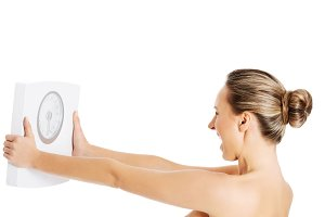 Nude topless woman holding scale.