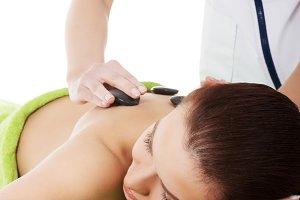 Beautiful woman lying on spa salon.