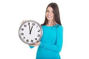 Young casual woman is holding a clock.