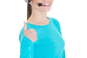 Young casual woman with headphones and microphone showing ok.