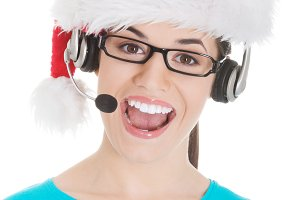 Young casual woman in santa hat and,microphone and headphones.