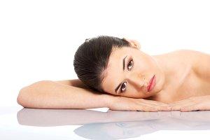 Portrait of beautiful woman lying on hands.