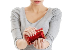 Beautiful casual woman showing her empty wallet.