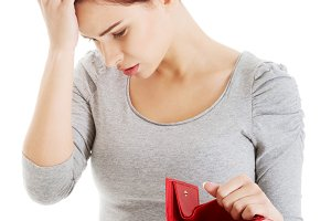 Beautiful casual woman with empty wallet, worrying.