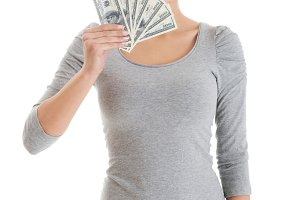 Beatiful casual woman holding money.