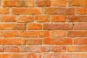 Medieval brick wall close up
