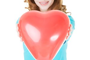 Attractive woman giving a baloon heart.