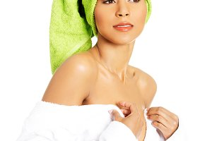 Attractive woman wrapped in towel with turabn.