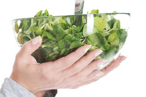 fresh, green lettuce in a glass bowl.