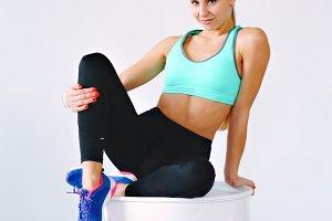 Sporty girl sitting