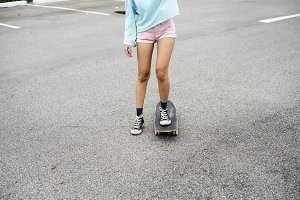 Hipster girl with skateboard