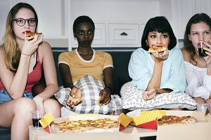 Girlfriends eating pizza together