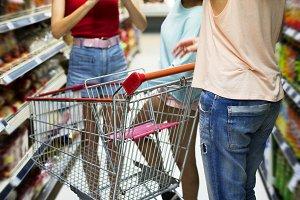 Girlfriends shopping in supermarket