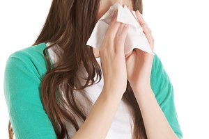 Young beautiful woman with tissue, handkerchief.