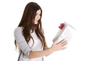 Young beautiful woman holding present with red bow.