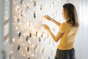 Girl decorate photo on the wall