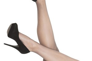 Woman's legs in black stockings and high heels.