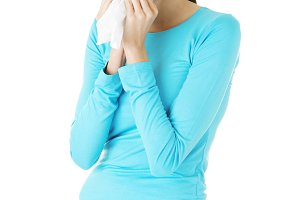Young casual woman with tissue.